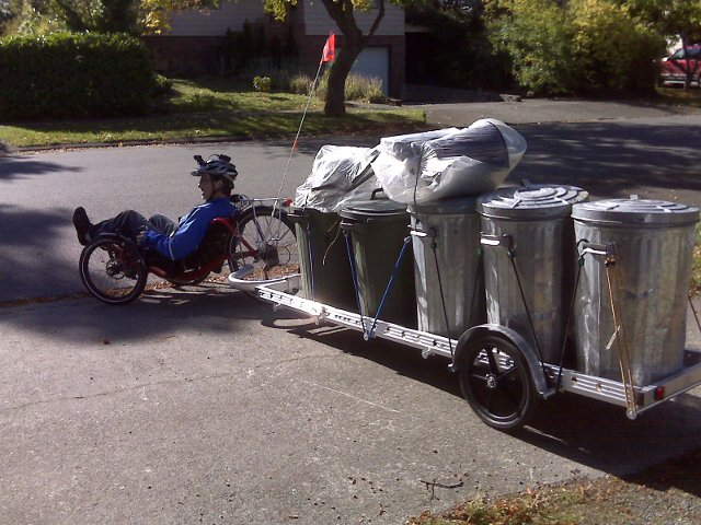 trike pulling a 96A bicycle cargo trailer loaded with recyclables