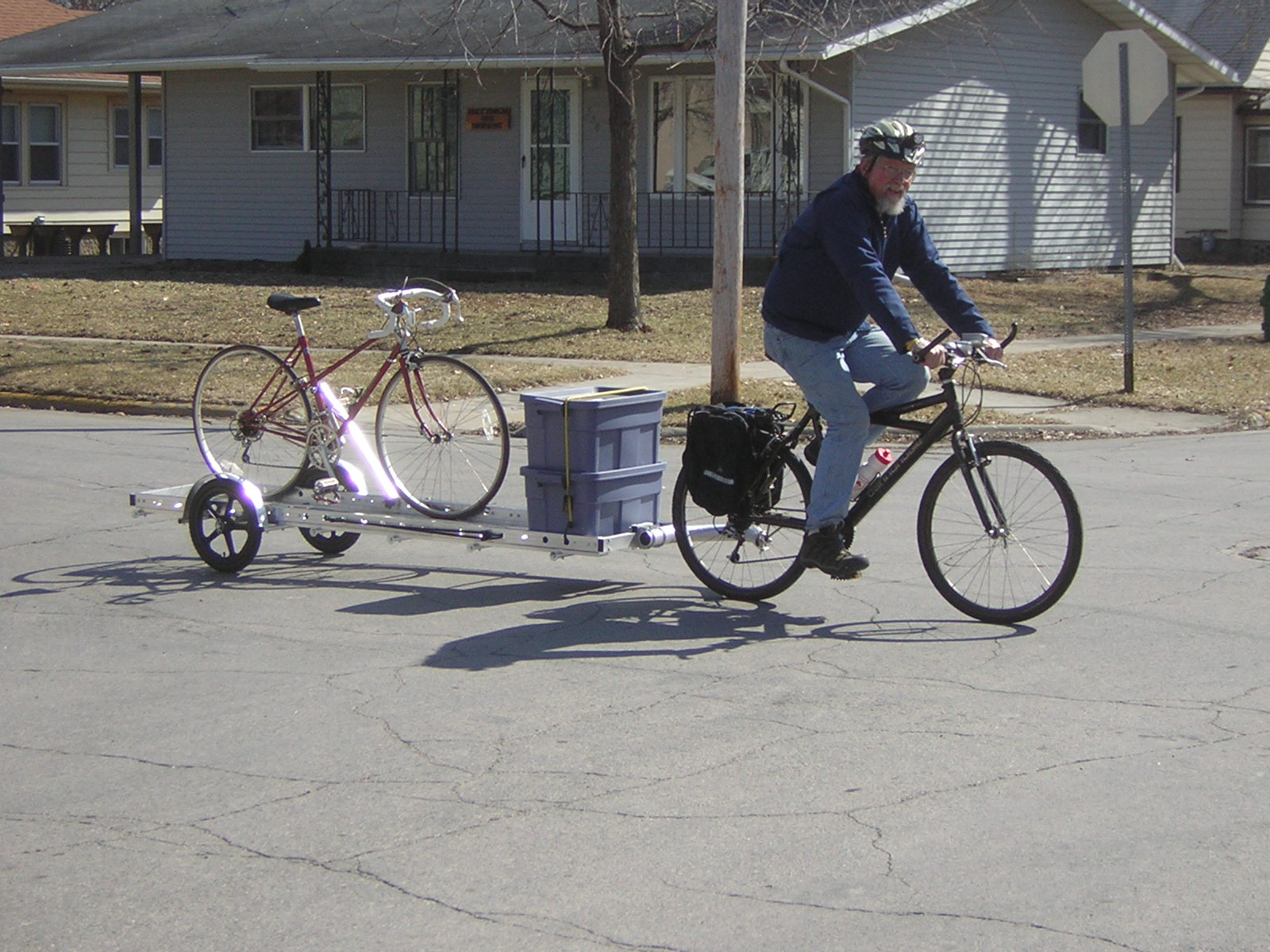 Bicycle Repair Man Craig Corson carrying a bike and his tools on a 96A trailer