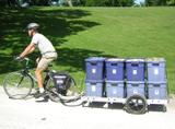 64A bicycle trailer carrying 8 bins of mulch